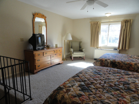 The Suite offers a TV in the bedroom and in the adjoining living/dining/kitchen, as well as two full baths.