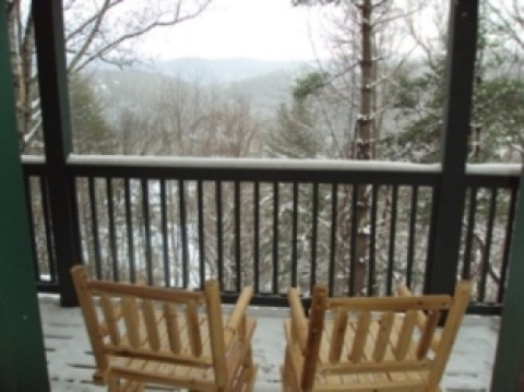 Hand-carved rocking chairs for reading or relaxing in the mountain air.