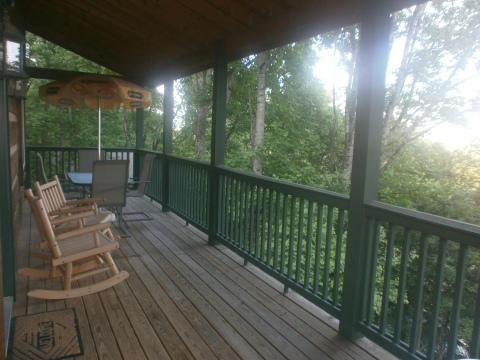Upper covered deck for grilling, dining, & socializing with friends & loved ones