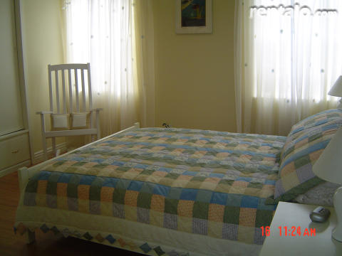 Yellow Room - features queen size bed, rocking chr