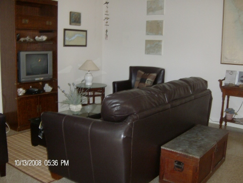 very comfortable leather couch and two tub chairs