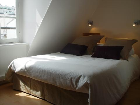 seperate bedroom with double bed - Paris Vacation Apartments