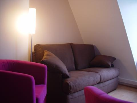 Living room with a sofa bed that sleeps 2 people - Paris Vacation Apartments