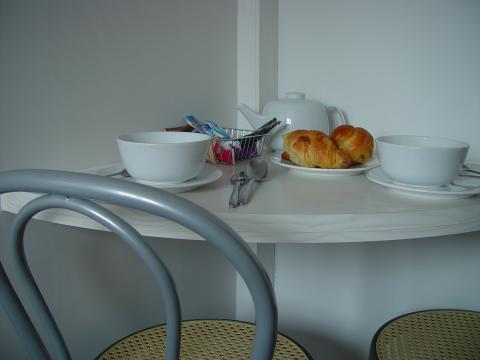Breakfast table in the kitchen - Paris Vacation Apartments