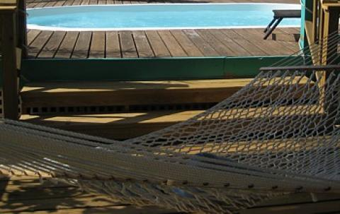 Hammocks are steched poolside - St John Vacation Homes