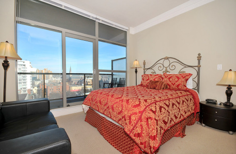 Master bedroom with city and mountain views.