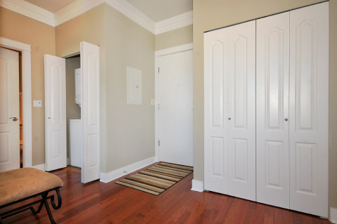 Entrance way with stackable in-suite laundry.