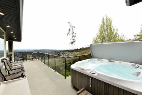 Main level deck with hot tub.