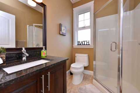 Main bathroom with walk in shower.