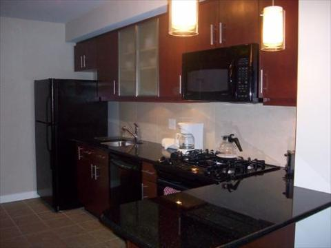 Full kitchen with granite counter tops